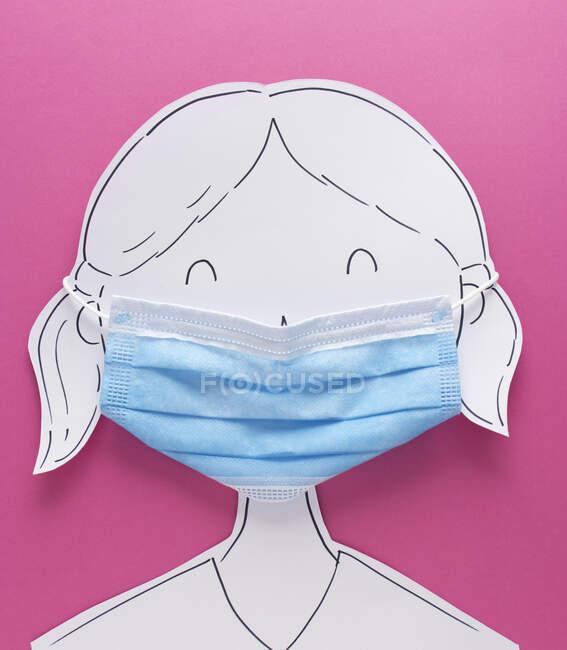 Menina conceitual usando uma máscara facial — Fotografia de Stock