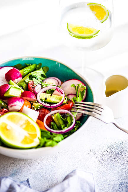 Organic vegetable salad with sesame seeds and oil served in a bowl — Stock Photo