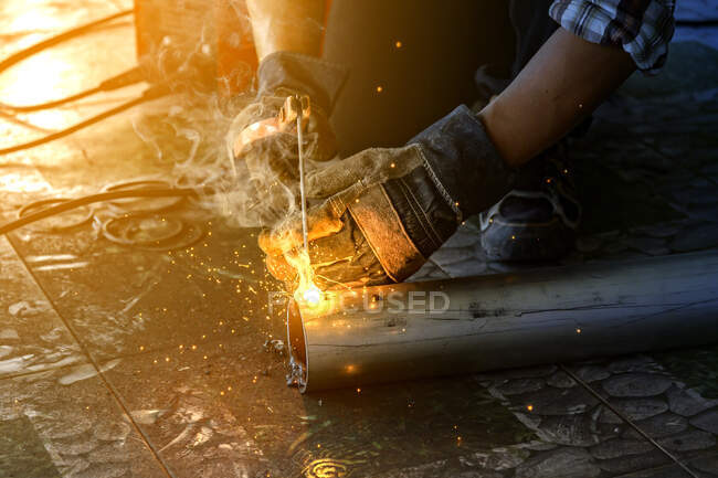 Close-up of a man welding steel pipes, Thailand — Stock Photo