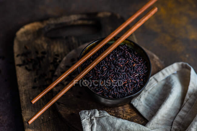 Raw organic black rice in a bowl as a asian cooking concept — Stock Photo