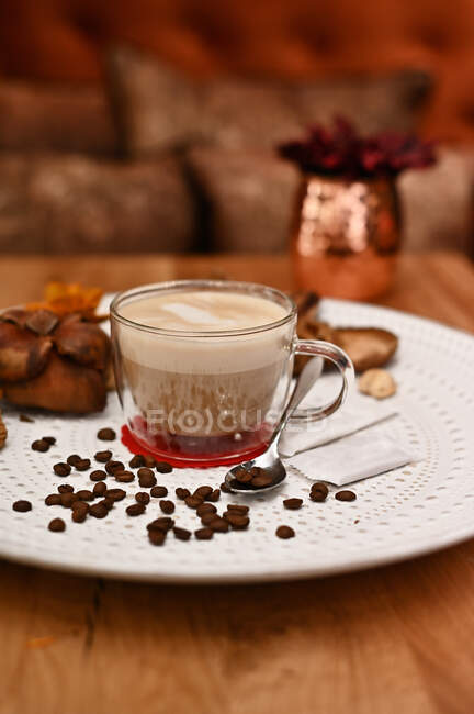 Cup of coffee on a plate with rustic decorations — Stock Photo