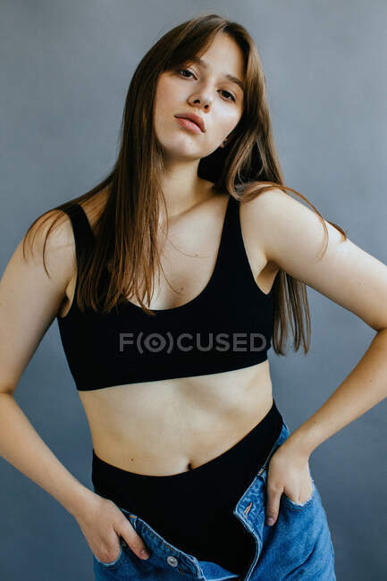 Portrait of a seductive woman in underwear and jeans — Foto stock