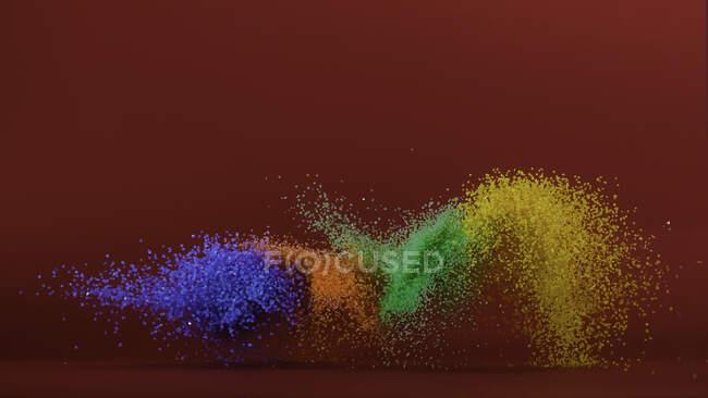 Arena multicolor volando por el aire - foto de stock