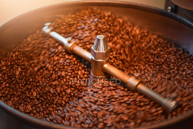 Coffee beans roasting in a factory, Thailand — Stock Photo