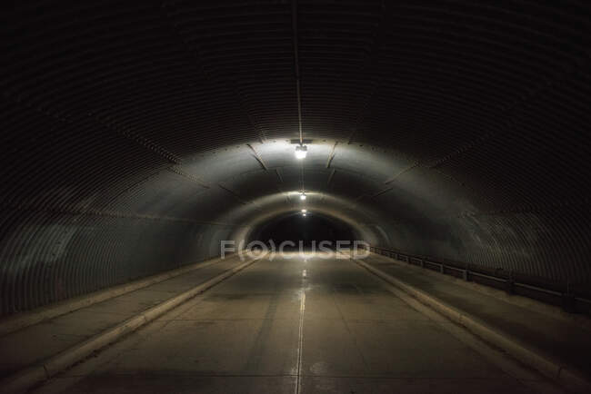 Road through a tunnel at night, USA — Stock Photo