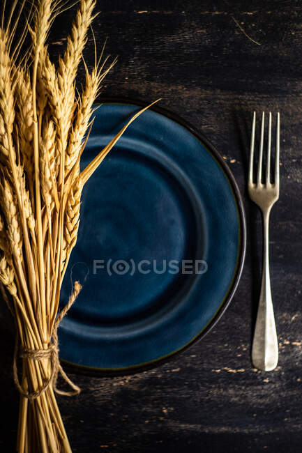 Thanksgiving day or autumnal harvest concept with frame with nuts, berries, vegetable and fruits on dark wooden background with copy space — Stock Photo