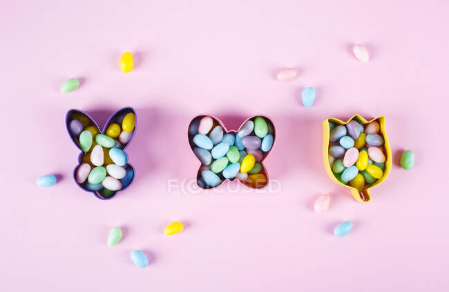 Overhead view of Easter candy inside cookie cutters — Stock Photo