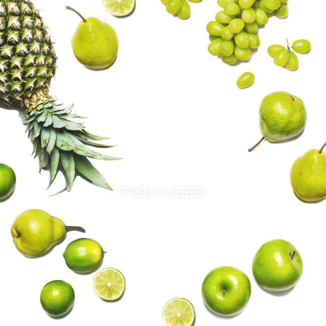 Green fruits on a white background. Fresh organic produce. Healthy food. Top view — Stock Photo