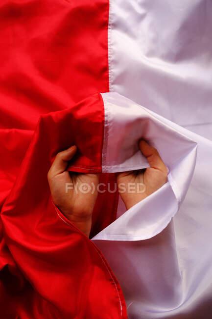 Manos con bandera indonesia, Indonesia - foto de stock