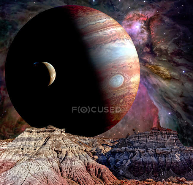 Conceptual shot of Jupiter and Io rising over the Jasper Forest, Petrified Forest National Park, Arizona, USA — Stock Photo