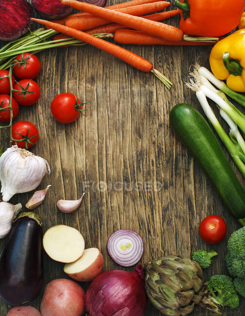 Fresh fruit and vegetables on a wooden table — Stock Photo
