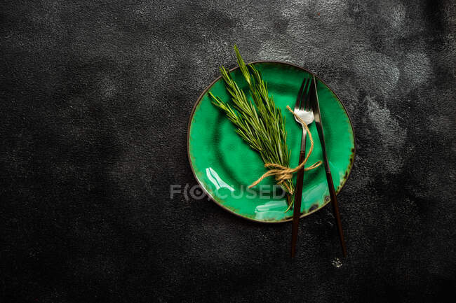 Bunch of tied rosemary decoration on a place setting — Stock Photo