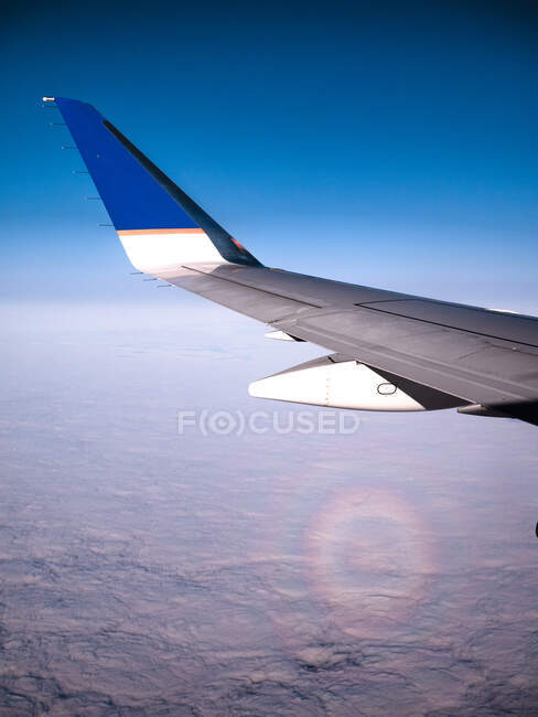 Aircraft in flight above the clouds — Stock Photo