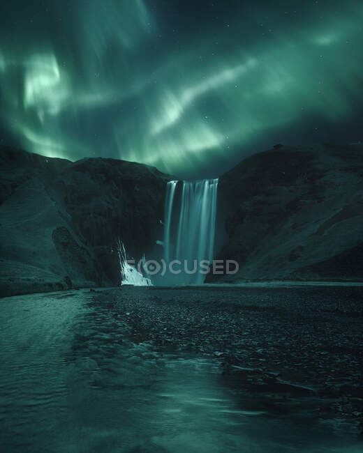 Northern lights over Skogafoss waterfall, Iceland — Stock Photo
