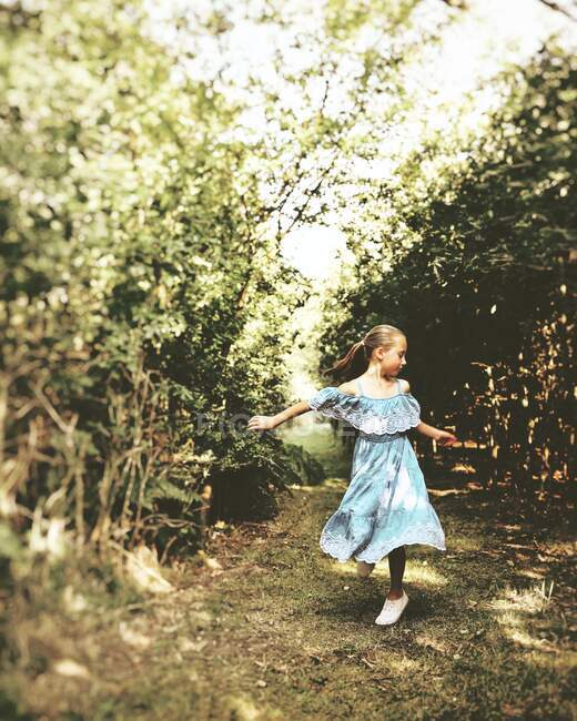 Girl standing in the forest dancing, United Kingdom — Foto stock