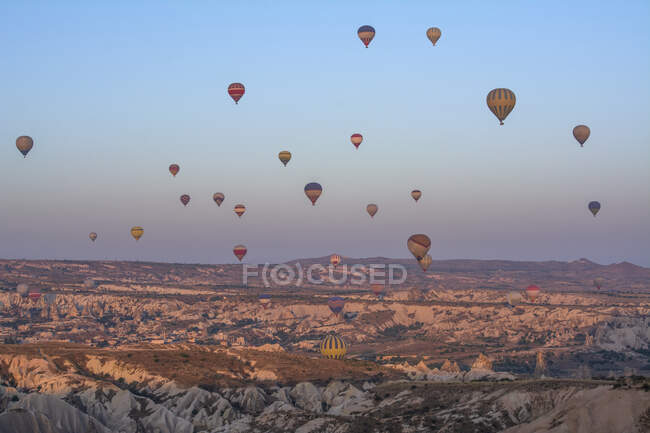 Hot air balloons flying over Cappadocia, Goreme, Turkey — Stock Photo