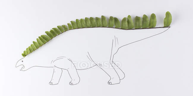 Conceptual dinosaur on white background — Stock Photo