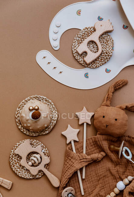 Overhead view of baby toys, accessories and a birthday cake — Stock Photo
