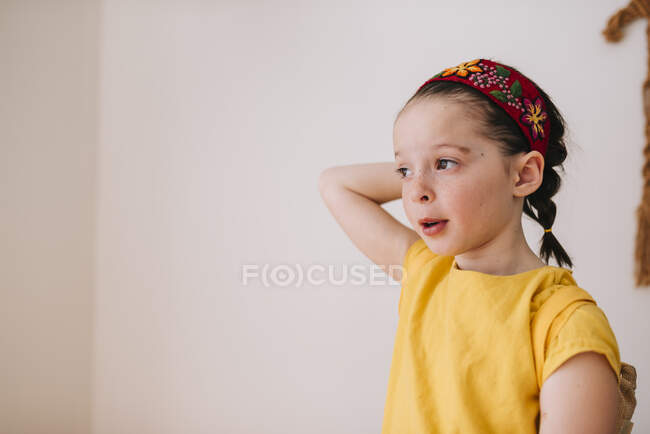 Portrait of a girl with her hand behind her head — Stock Photo