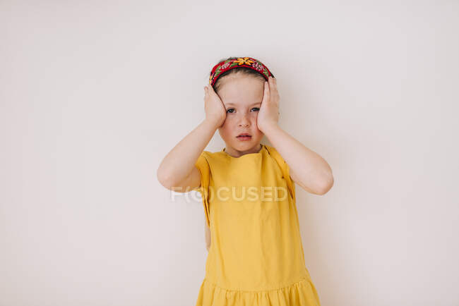 Portrait of a girl with a headache on white background — Stock Photo