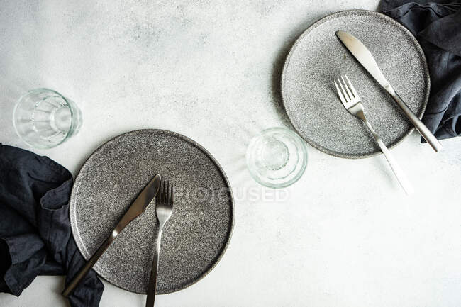 Overhead view of two minimalistic place settings on a  table — Stock Photo