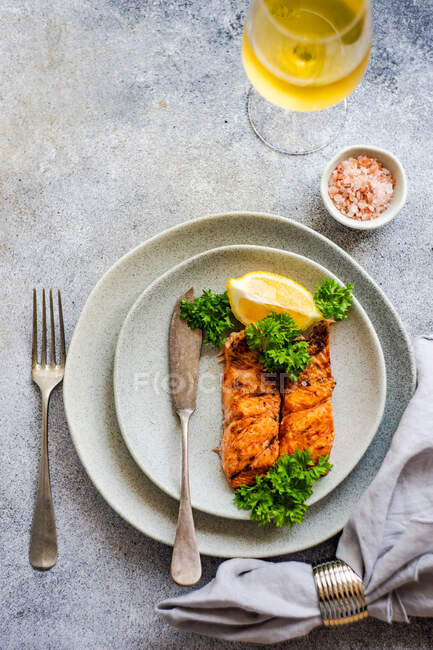 Two Grilled salmon steaks with a glass of white wine — Stock Photo