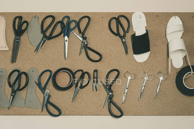 Top view of various tools and scissors at shoemaker workshop — Stock Photo
