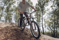 Cropped image of racer on mountain bike — Stock Photo